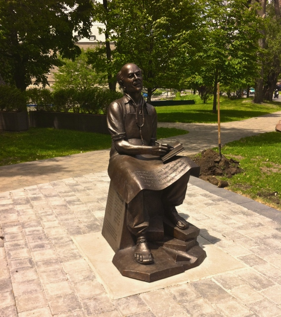"The life-size bronze sculpture of Dr. Bethune at the University of Toronto St. George Campus. The sculpture is inscribed with Dr. Bethune's quote, """"… I am content. I am doing what I want to do. Why shouldn't I be happy – see what my riches consist of. First I have important work that fully occupies every minute of my time… I am needed."" © Abtin Parnia."